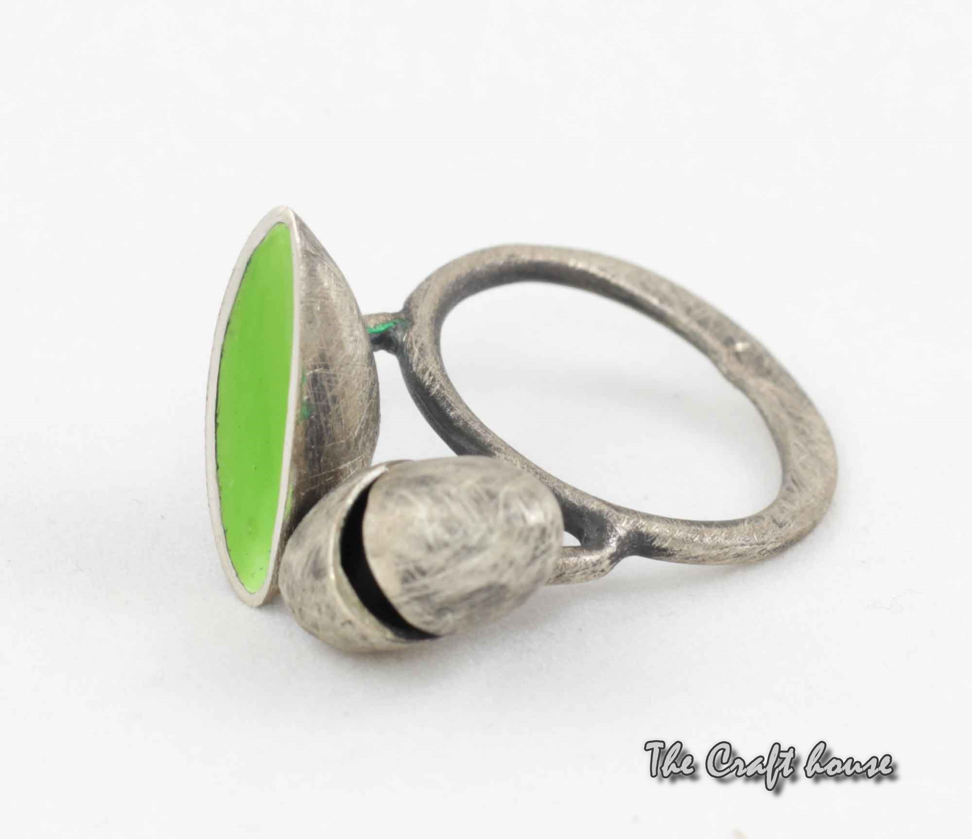 Silver ring with green enamel