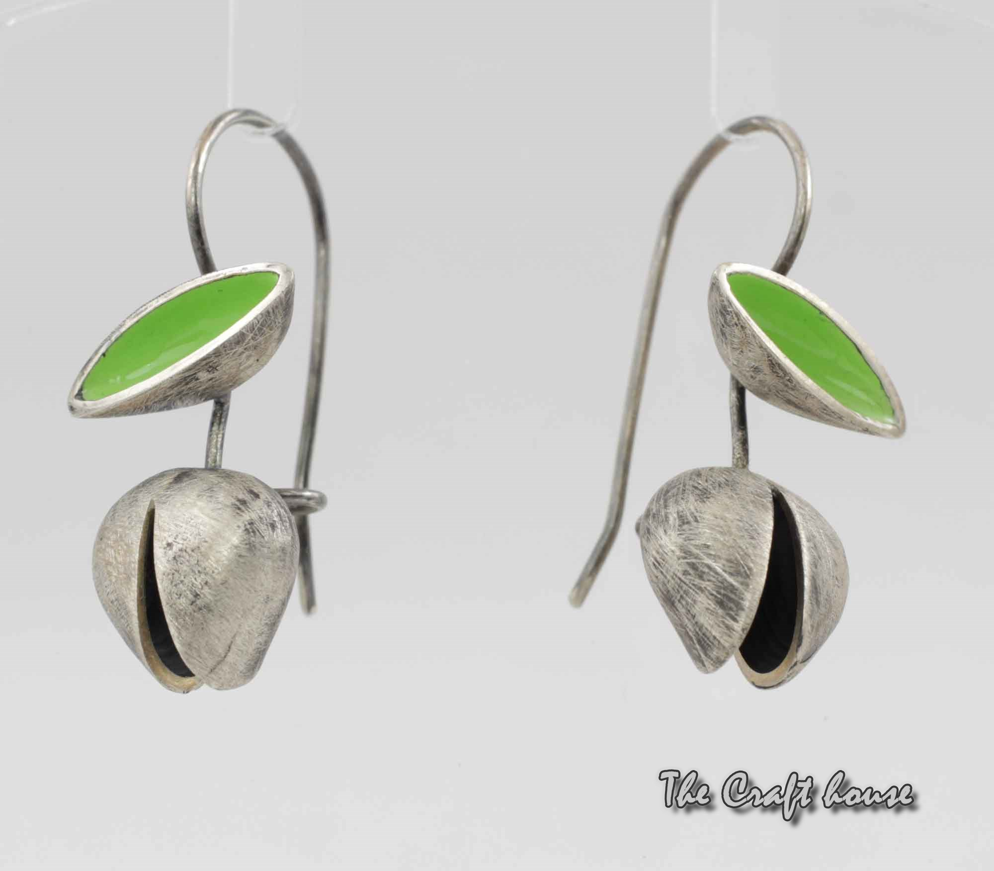 Silver earrings with green enamel