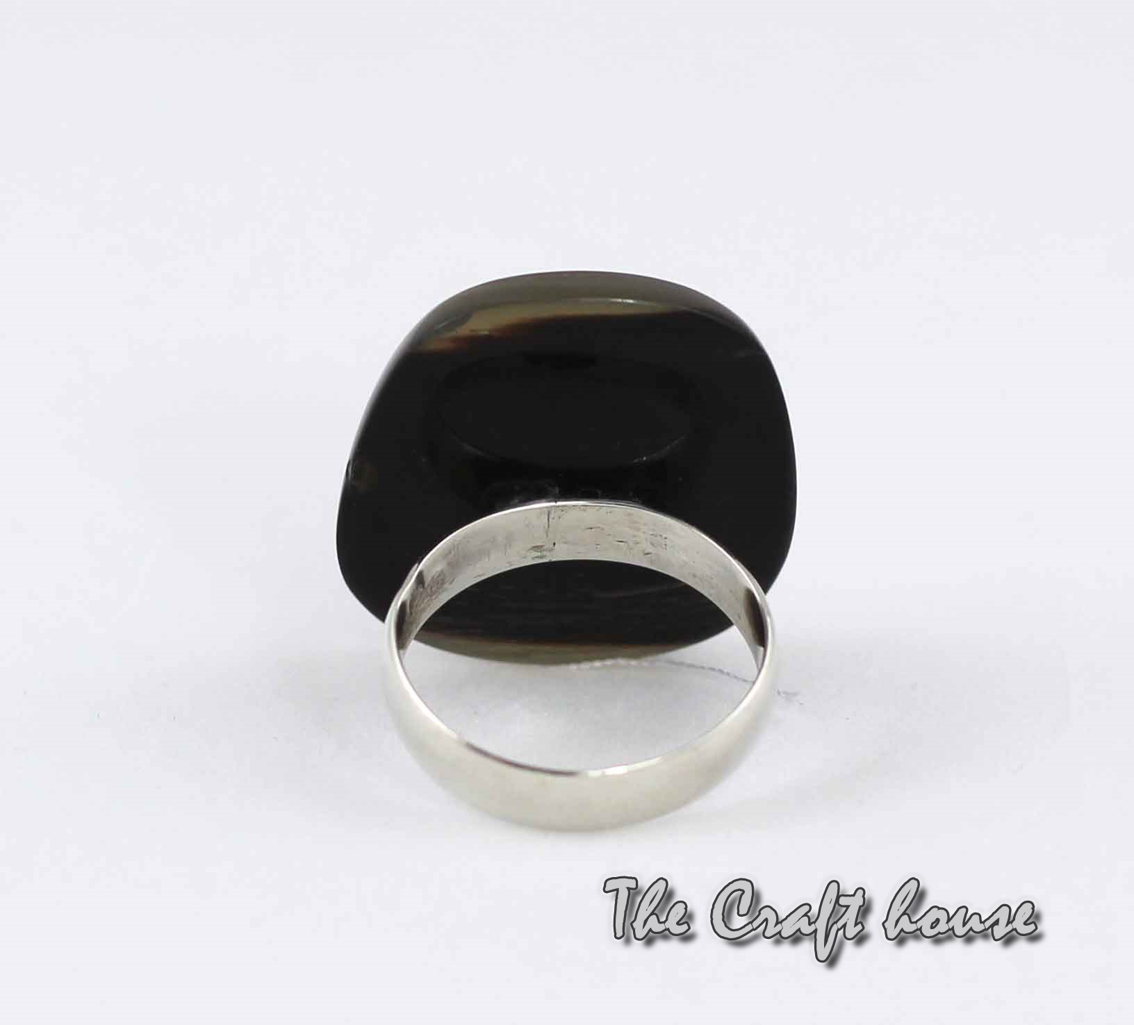 Ring with horn