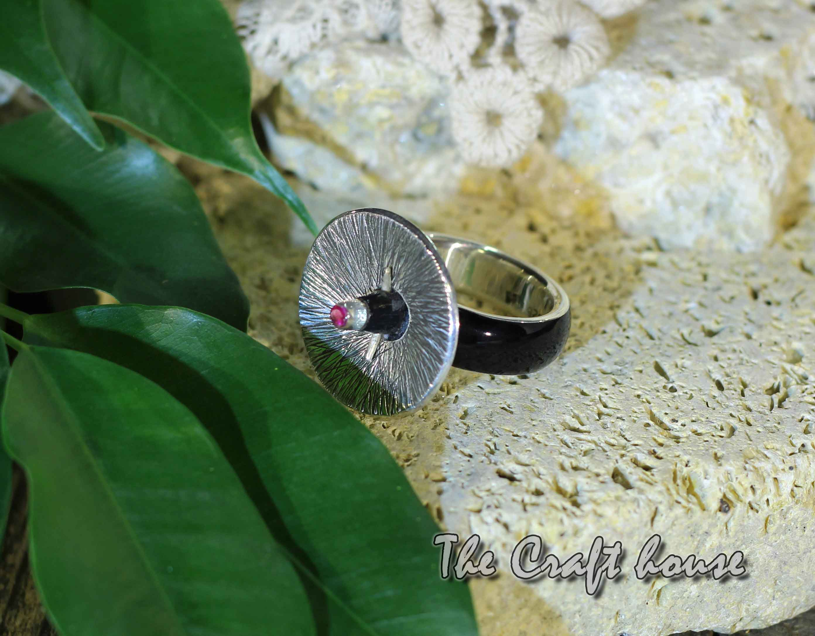 Silver ring with horn