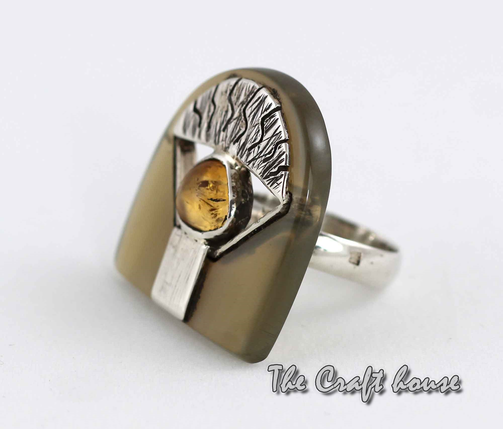 Silver ring with horn and Amber