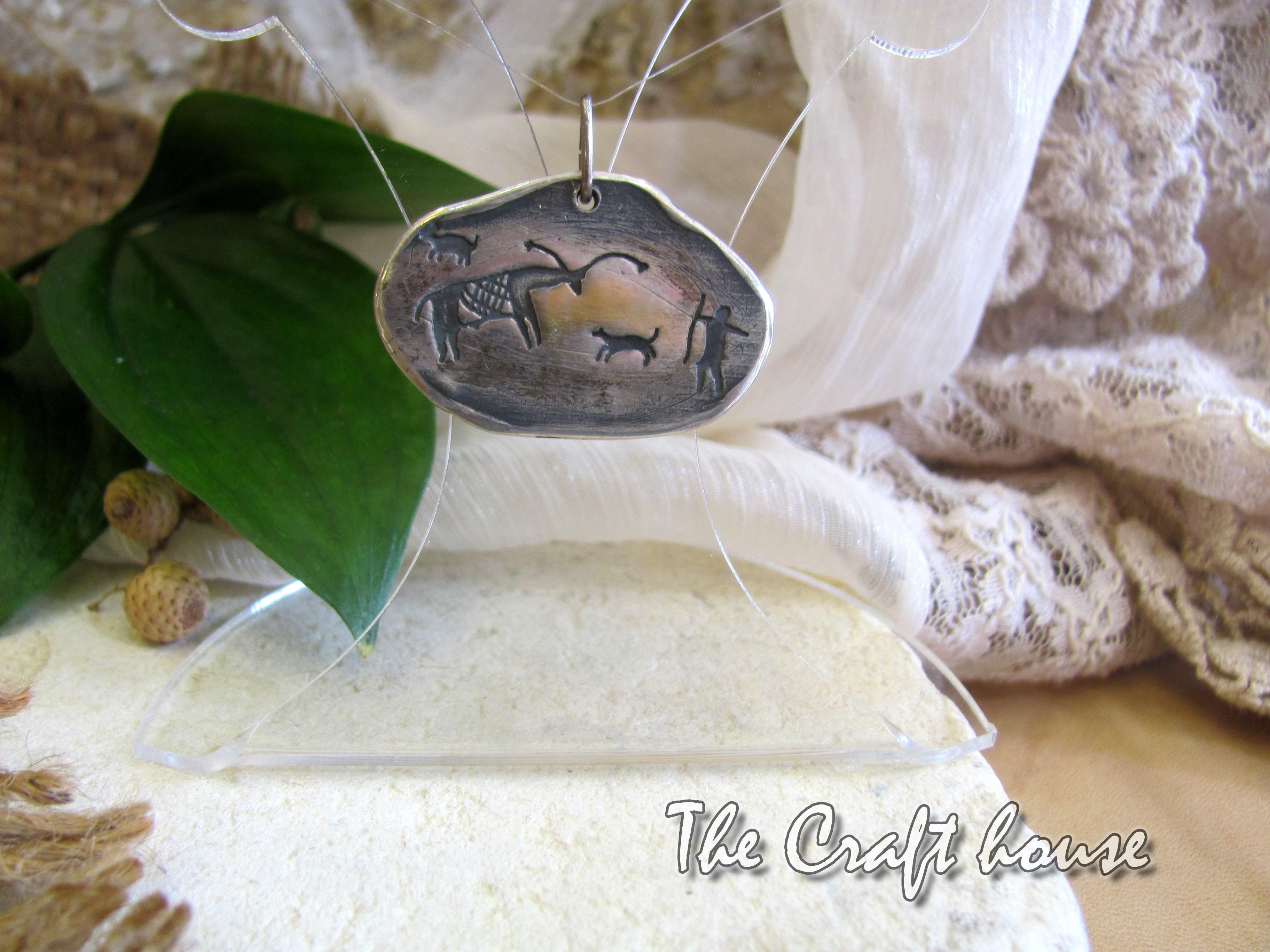 Silver pendant 'Prehistory'