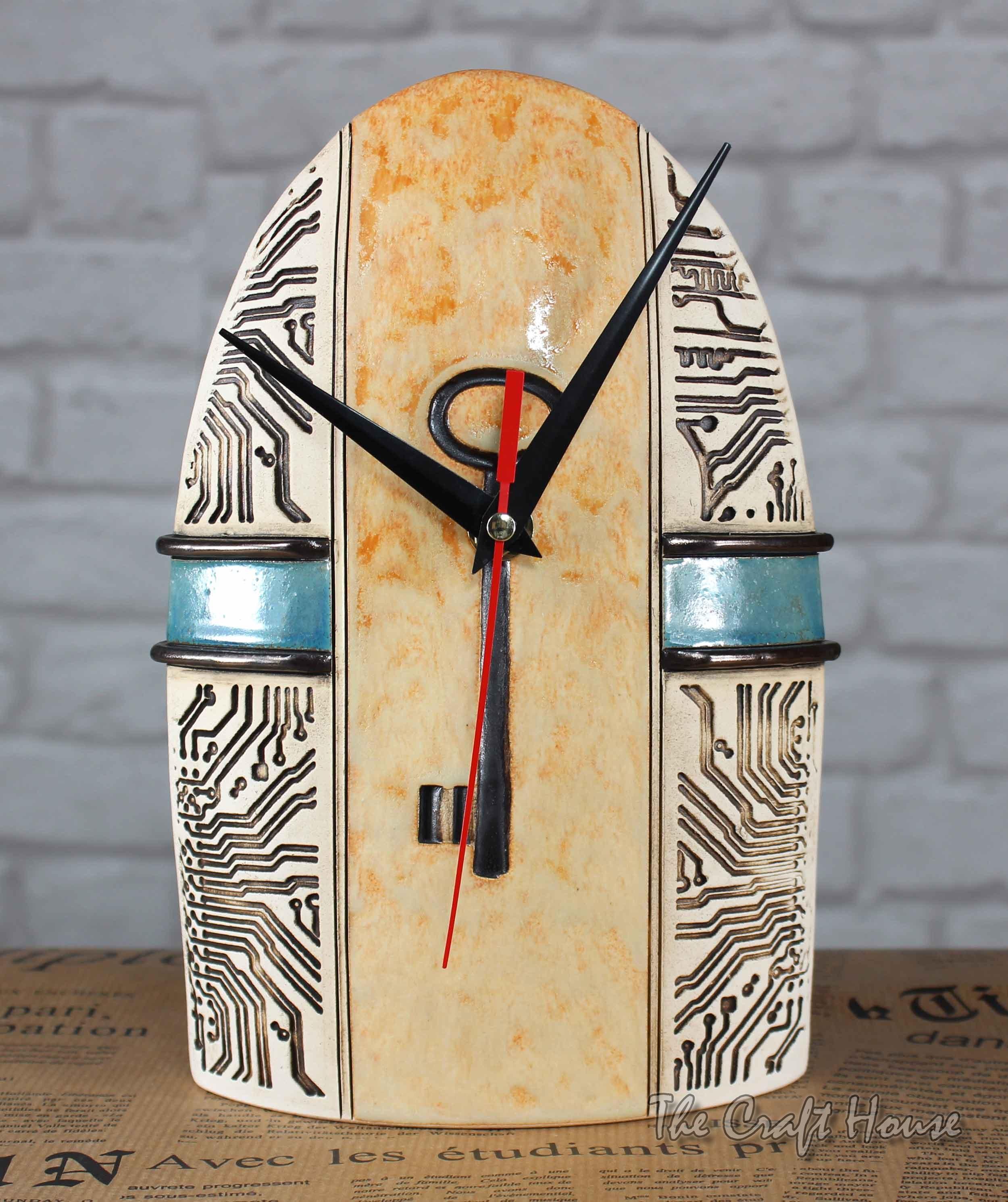 Ceramic clock with key decoration