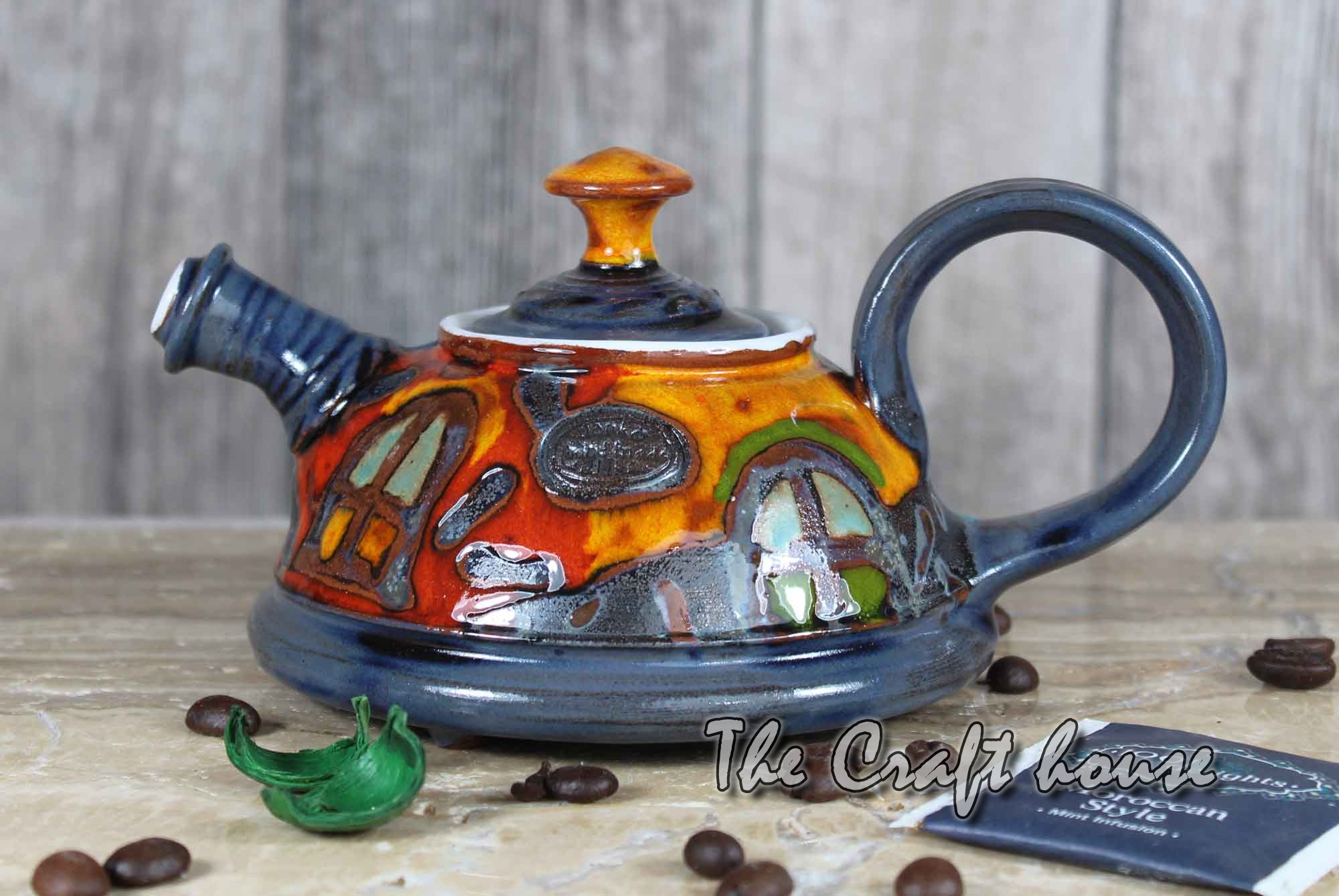 Cute pottery teapot