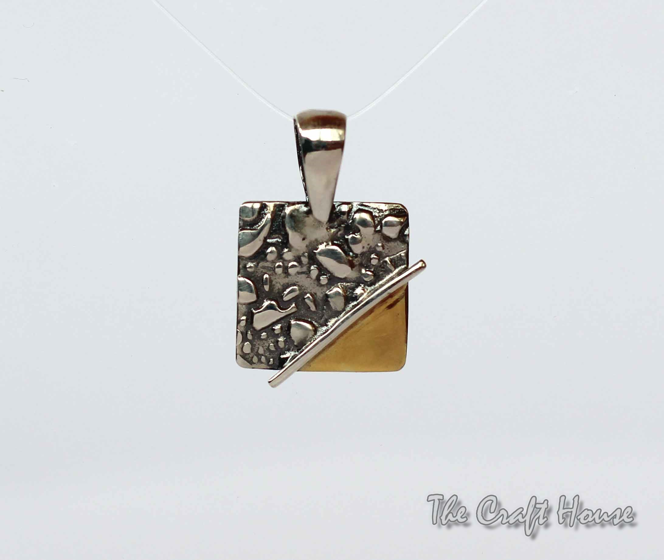 Silver pendant with gold - plating