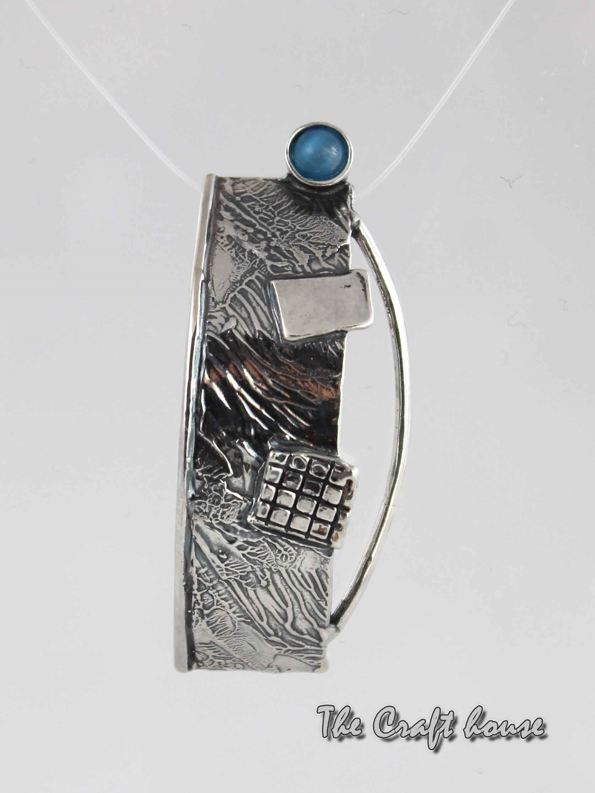 Silver pendant with Cat's eye stone