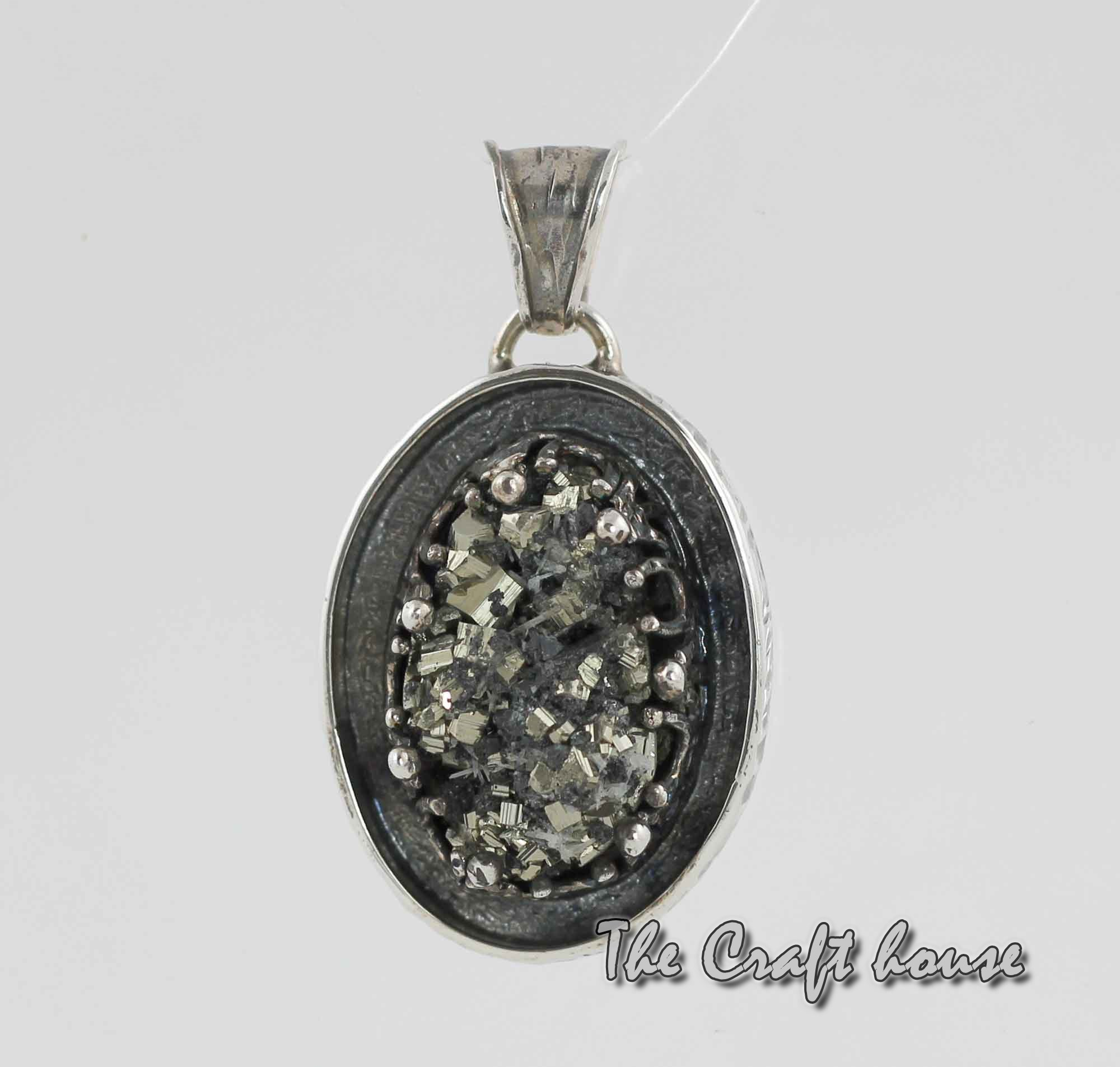 Silver pendant with Pirite
