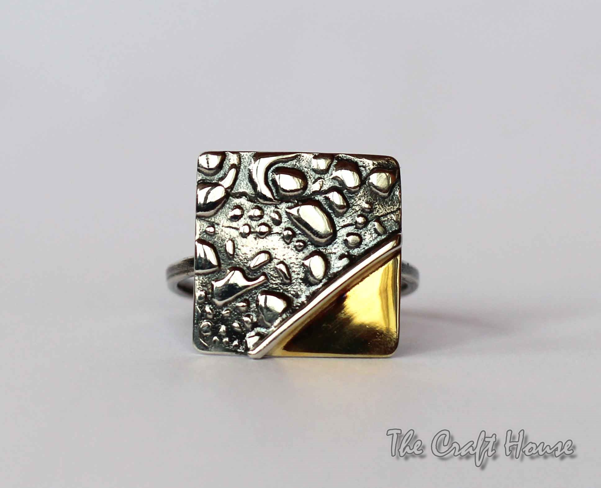 Silver ring with gold - plating