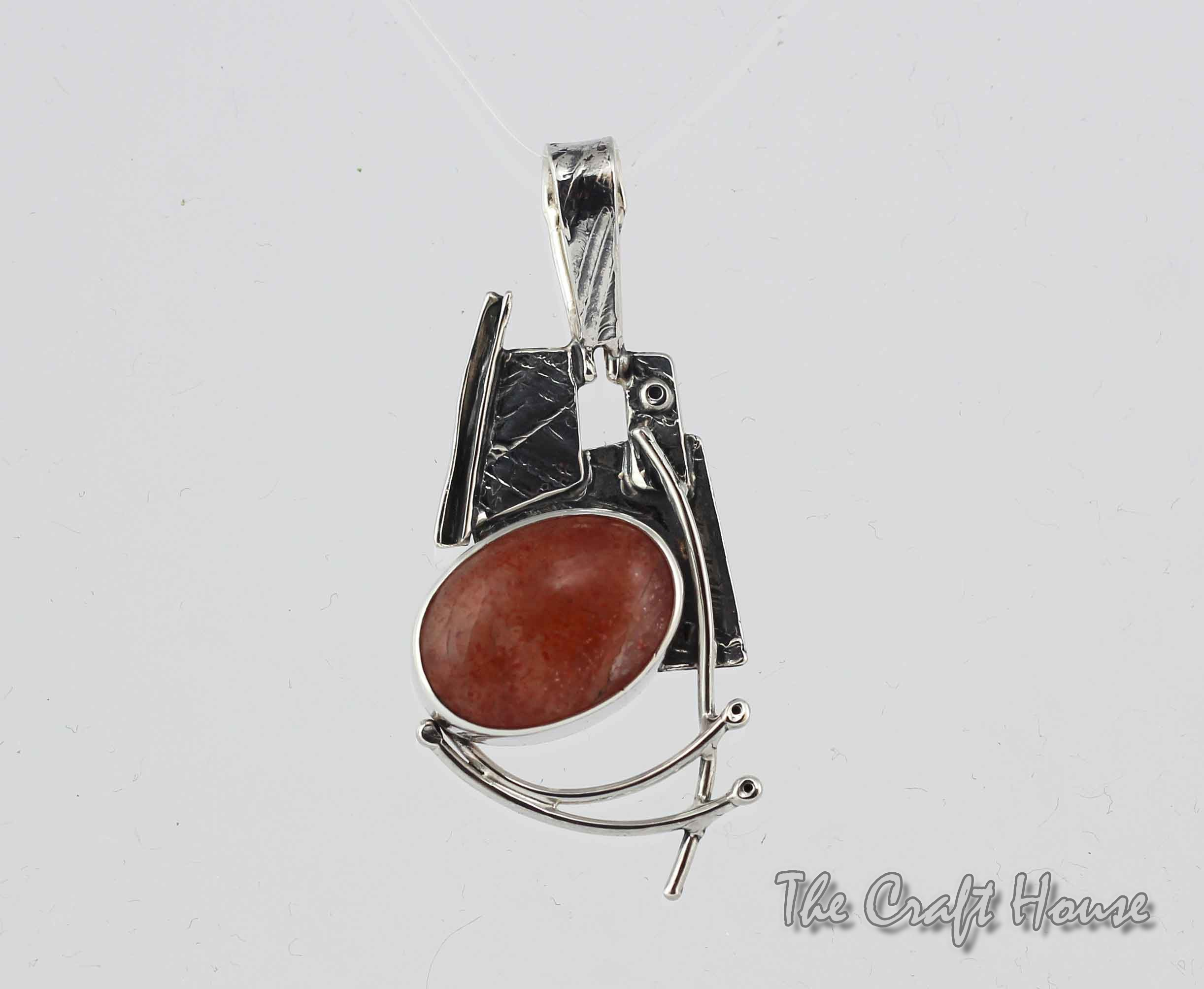 Silver pendant with Sunstone