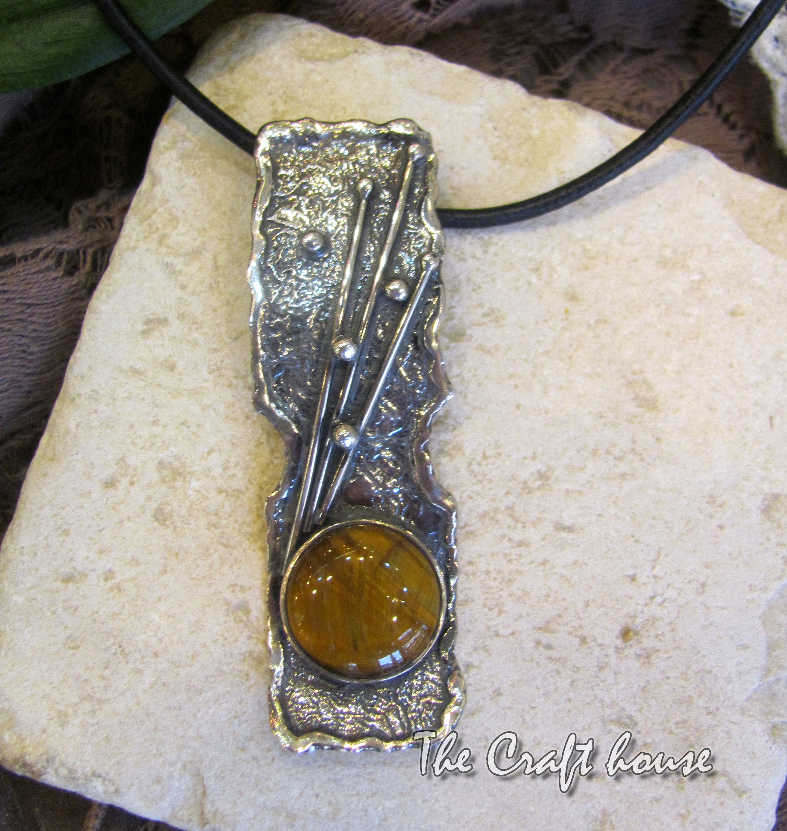 Silver necklace with Tiger's eye