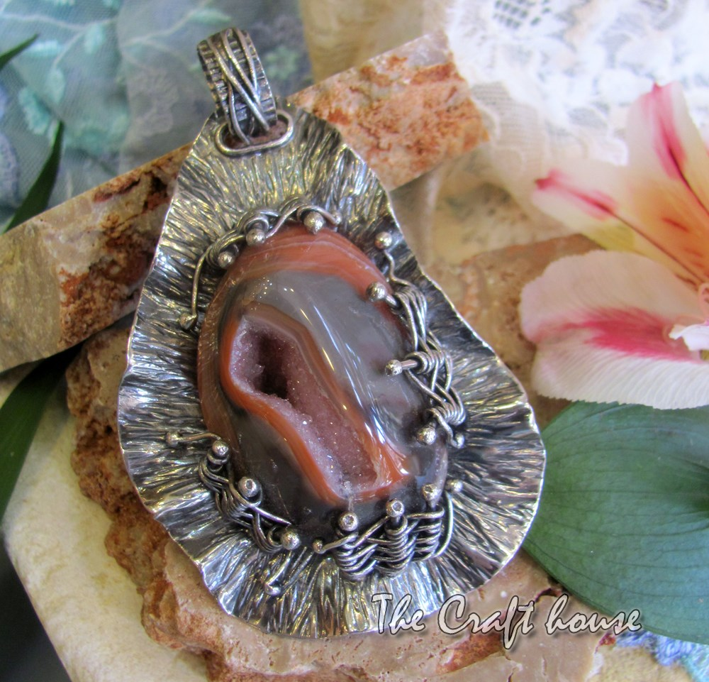 Silver pendant with natural druse of Agate