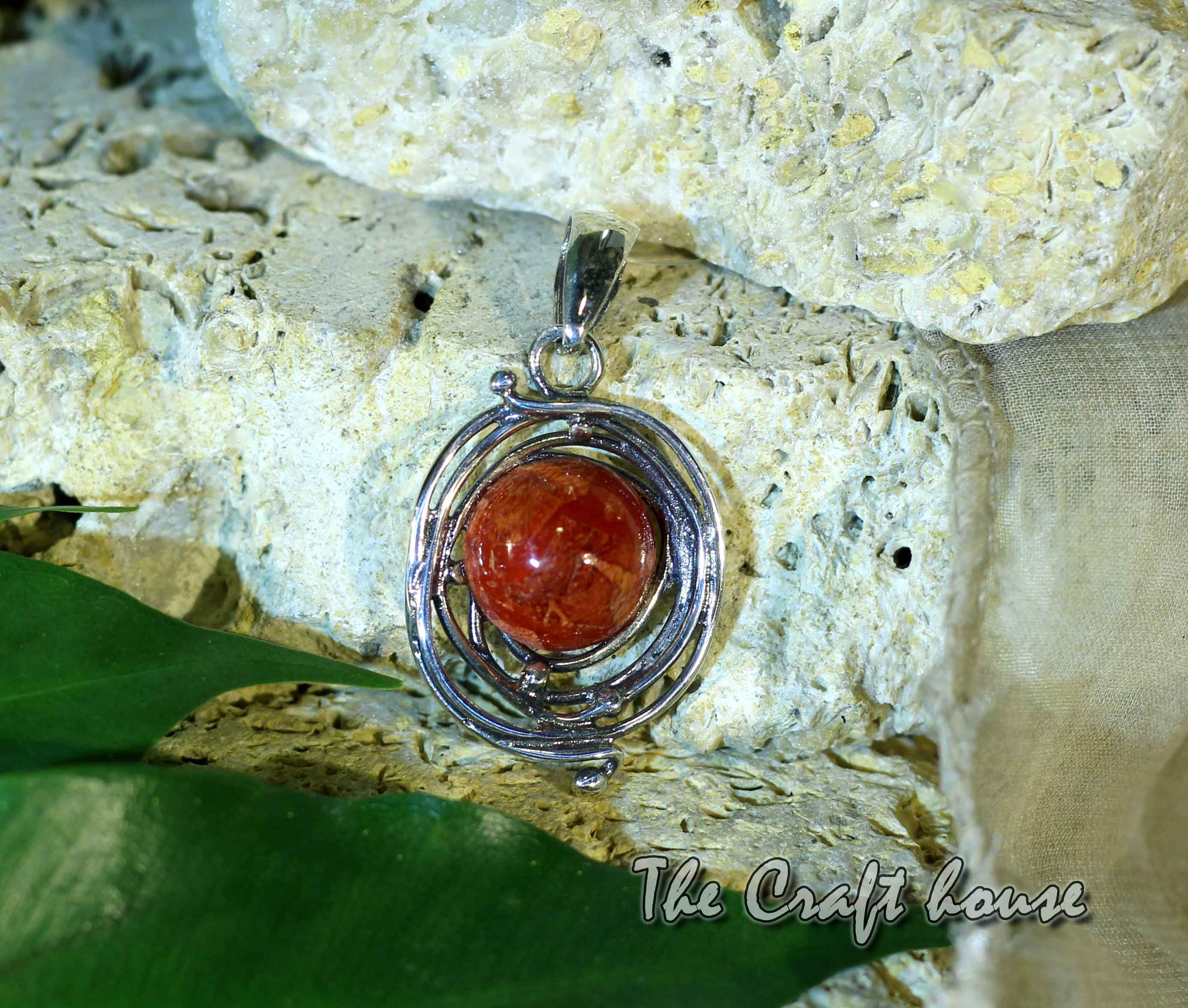Silver pendant with Coral