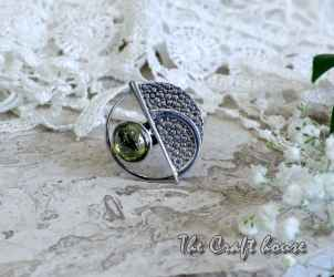 Silver ring with Olivine