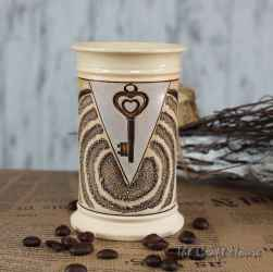 Ceramic cup with a key decoration