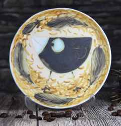 Ceramic saucer with Bird