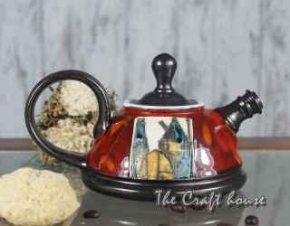 Cute pottery teapot