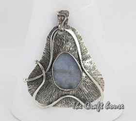 Silver pendant with Quartz
