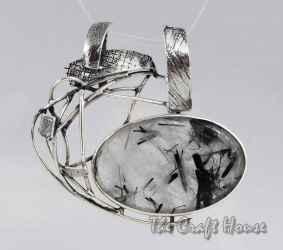 Silver pandantwith Rutile quartz